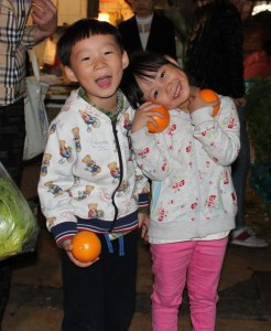 PRC Shanghai 13 Jiulong Rd kids and oranges copy a