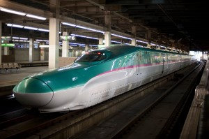 Hayabusa (Peregrine Falcon) or E5 shinkansen train at a mainline railway station in japan
